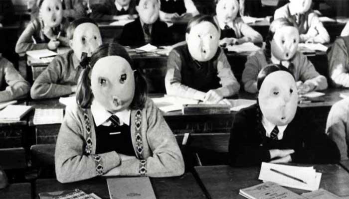 """Cena de """"The Wall"""", ópera rock do Pink Floyd: escolas massacrando alunos, matando sua criatividade e colaboração, e promovendo a competitividade – Imagem: reprodução"""